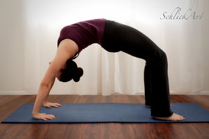 Urdhva Dhanurasana (Upward Facing Bow Pose)